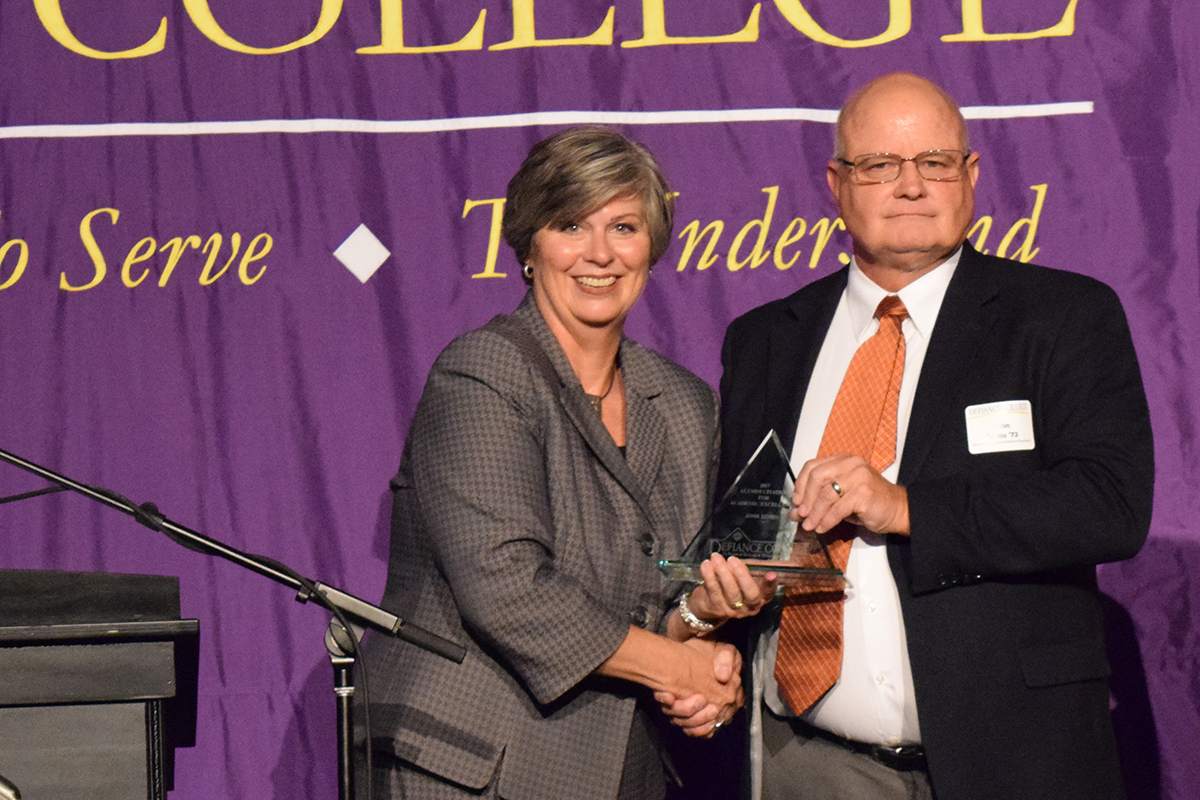 John Scheu receives Alumni Citation of Academic Excellence from Defiance College.
