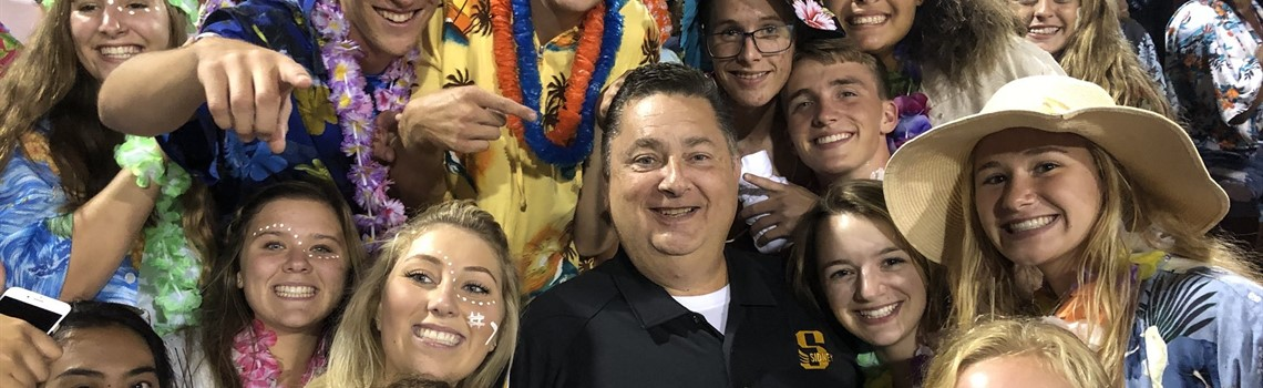 The Jacket Pack student spirit group welcomes Superintendent Bob Humble at the first home football game.