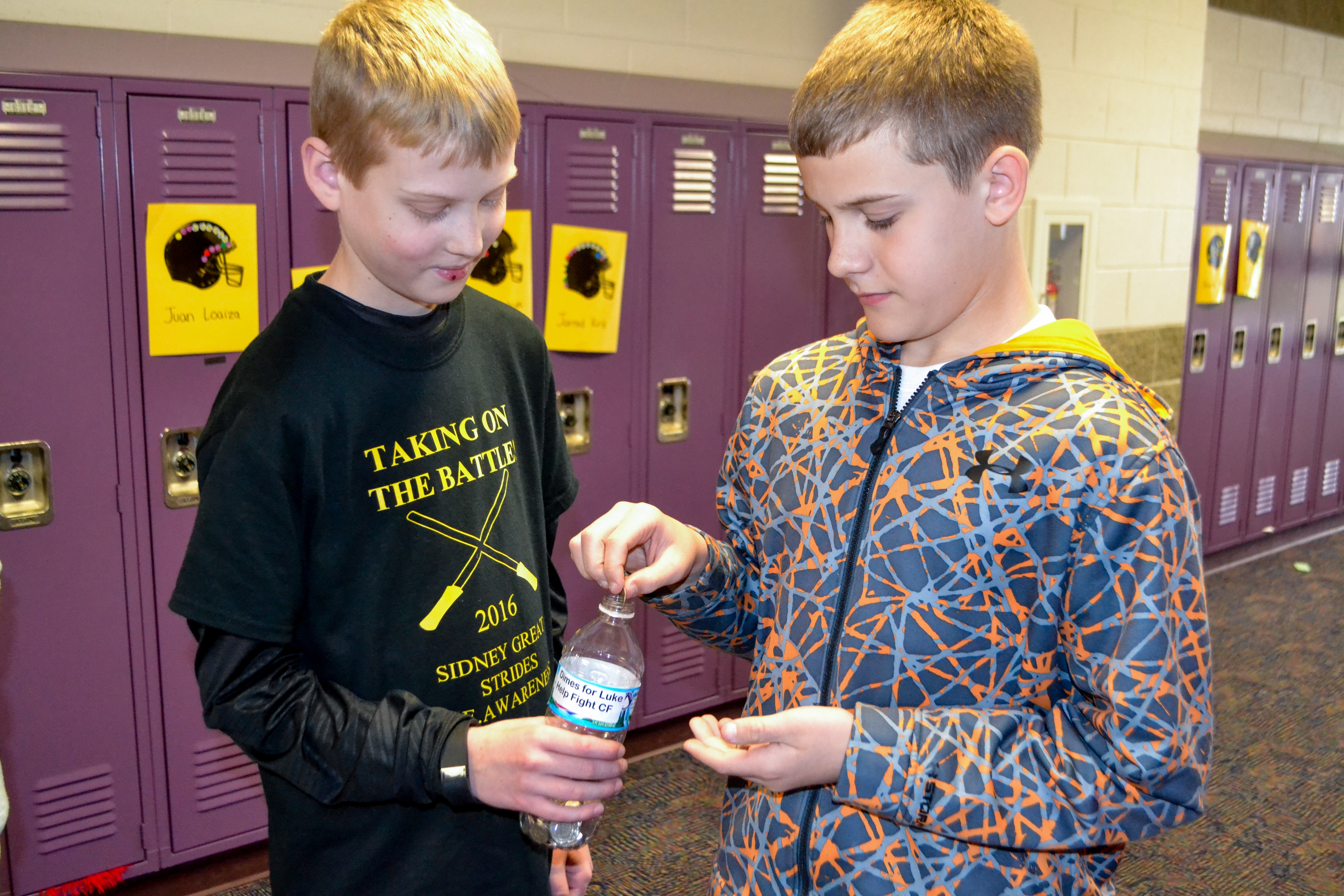SMS 6th grade students collect dimes for the Cystic Fibrosis Foundation in honor of their classmate Luke Bemus.
