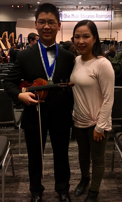 Nobel Zhou stand with former Orchestra Director Janet Fu.