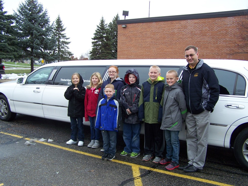 Northwood students enjoy a limo ride to Pizza Hut with Mr. Barr as an award for selling items for the Fall fundraiser