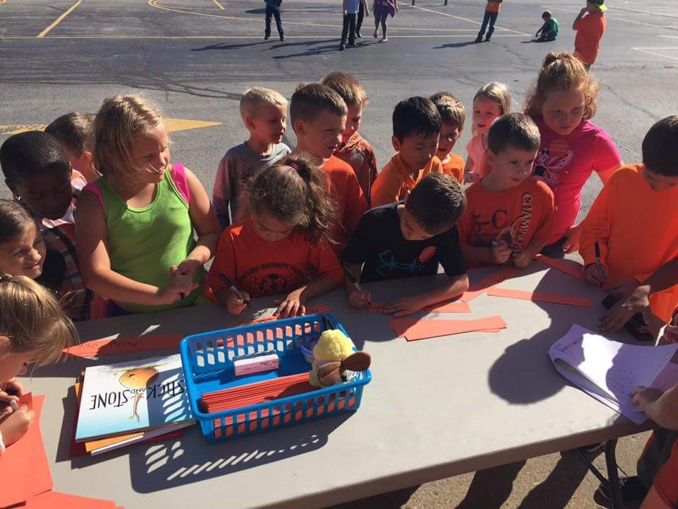 Students wear orange and sign a pledge to be bully-free on Unity Day