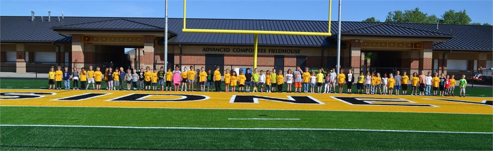 Emerson kindergarteners checking out the new turf on the last day of school.